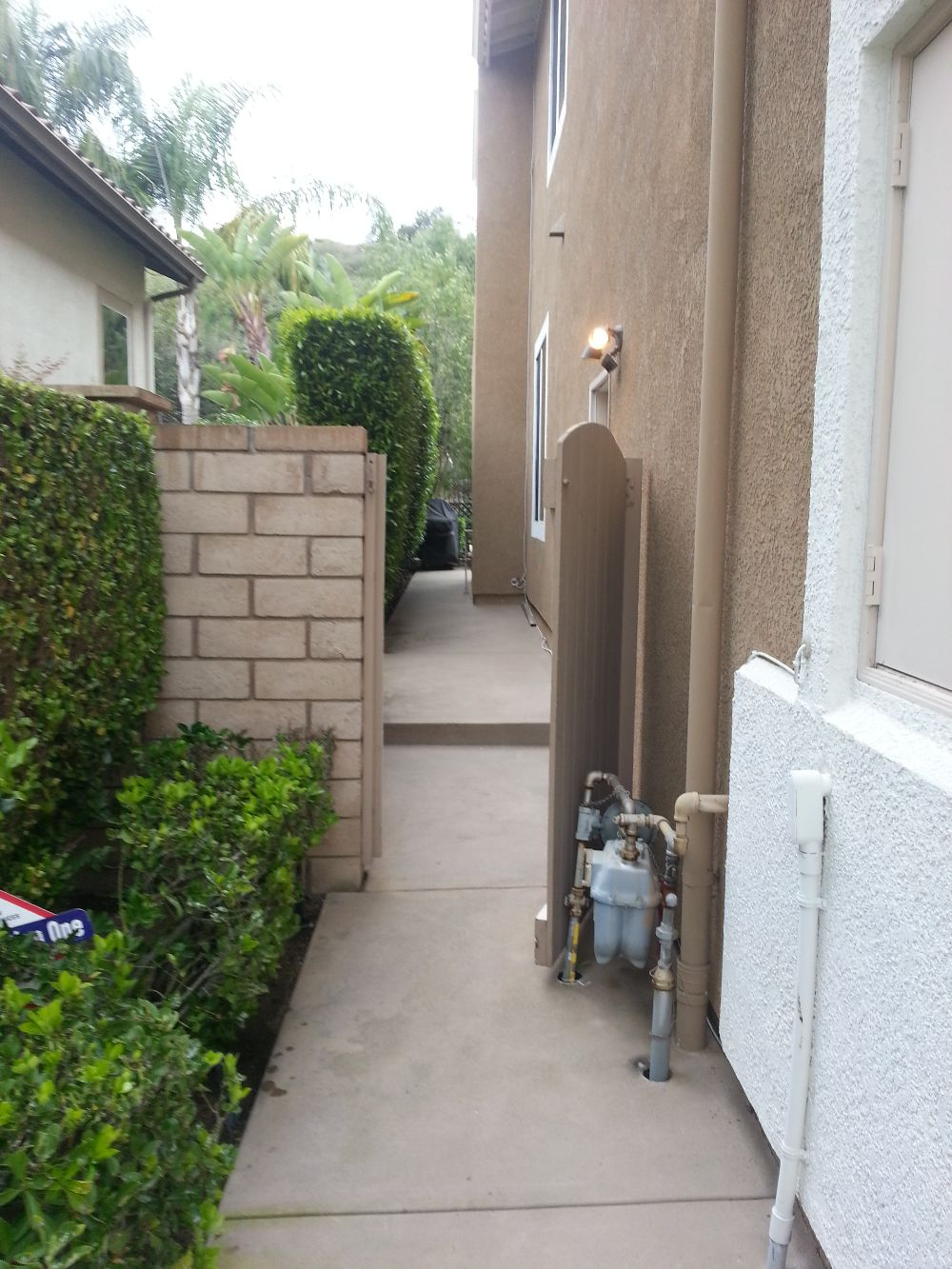 Spa removal from a narrow access back yard 1